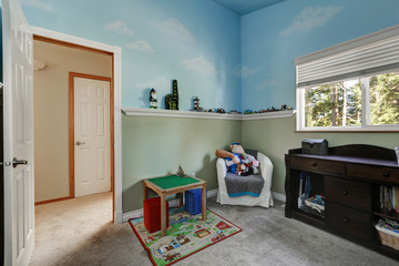 Kid's play room with blue sky painted walls