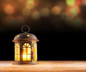 candle lamp lantern glowing on dark
