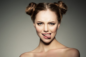 Emotional girl. Beautiful modern model shows tongue Positive wom