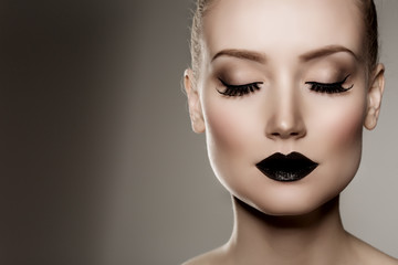Black lips. Halloween Makeup. Luxury beautiful woman with dark l