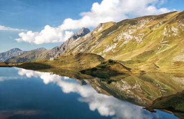 Aluminium Prints Reflection sky reflected in alpine lake