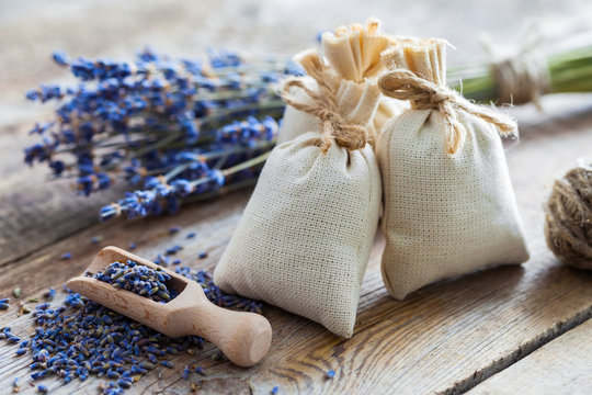 Bunch of lavender flowers and sachets filled with dried lavender