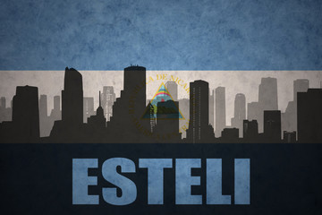 abstract silhouette of the city with text Esteli at the vintage nicaraguan flag
