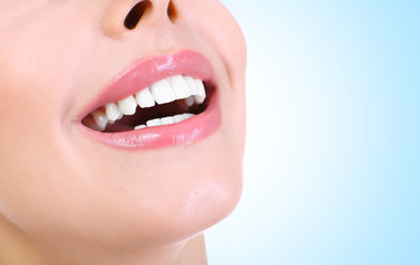 Young woman smile with white teeth, closeup. Dentist concept.