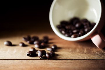 Vintage coffee bean on brown wooden