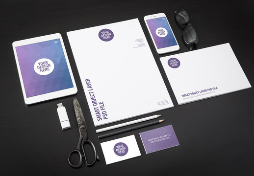 Smartphone, Tablet, and Stationery on Black Background Mockup