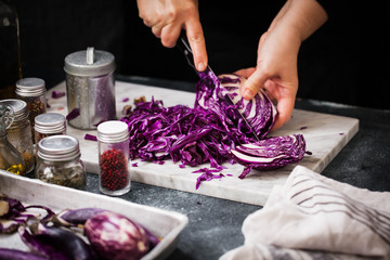 Red cabbage. Chef preparing Red Cabbage coleslaw in glass jar on marble table.