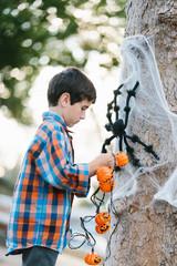 Boy making Halloween decoration.