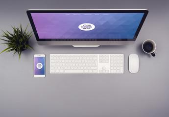 Desktop Computer and Smartphone on a Gray Desk Mockup 1