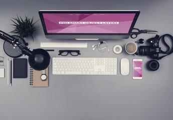 Desktop Computer and Smartphone on a Gray Desk Mockup 3