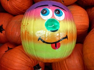 Smiling Painted Pumpkin In A Patch