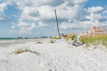 White sand, sea oats and a sailboat on Pass-A-Grille's beach