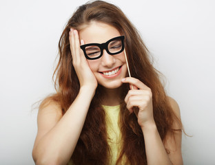 Attractive playful young woman with false glasses
