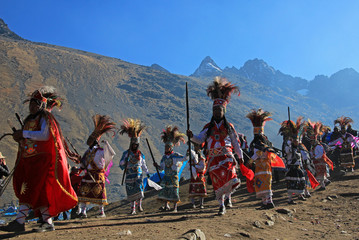 Parade at Quyllurit'i inca festival in the peruvian andes near ausangate mountain, one of the oldest, nicest and most traditional religious ceremonies in the world