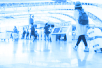 People traveling at airport terminal in blurred motion with retro color effected, Abstract blur people background