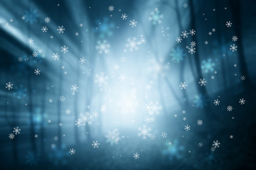 Abstract blurred foggy forest with snowflakes