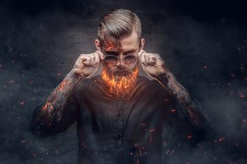 An evil man with burning beard. Wall mural