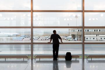 Man waiting at airport terminal