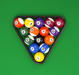 Pool balls pyramid on green cloth