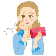 財布を持ってため息をつく女性