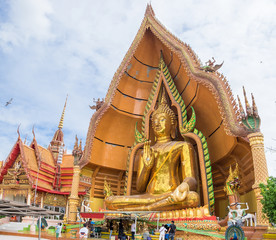 Gold big buddha statue in temple at wat tham sua, kanchanaburi, thailand