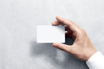 Hand hold blank white card mockup with rounded corners. Plain call-card mock up template holding arm. Plastic credit namecard display front. Check offset card design. Business branding. Wall mural