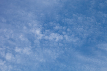 White clouds on a blue sky. Selective focus