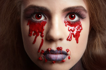 Beautiful girl with creative make-up for the Halloween party