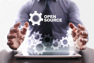 Businessman is using tablet pc and selecting open source