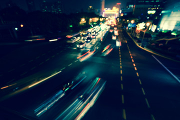 Artistic style -Defocused urban abstract texture bokeh city lights & traffic jams in the background with blurring lights.