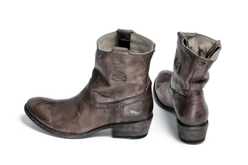 Pair of traditional cowboy boots retro tone