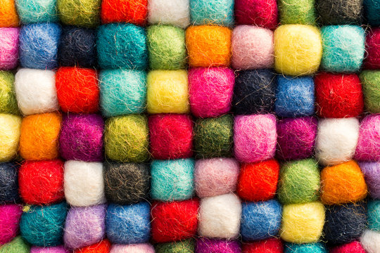 Geometric background with balls of colored synthetic wool