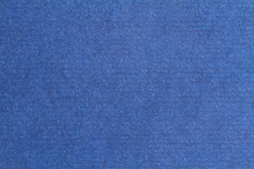 Blue paper texture, dark background