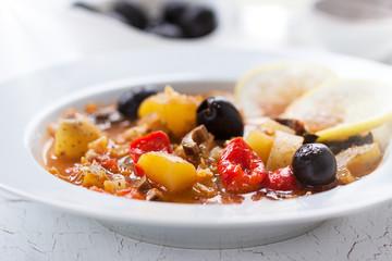 Italian seasonal vegetable soup in a restaurant, closeup, horizontal