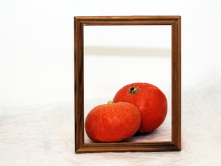 photo frame and vegetables, fresh pumpkin