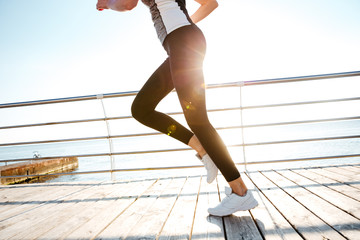 Cropped image of a runner woman feet in action
