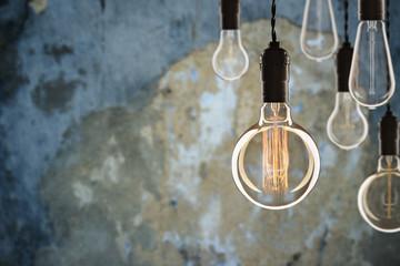 Idea and leadership concept Vintage incandescent Edison bulbs on