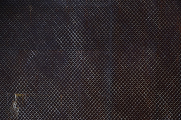 Metall texture with rusty mesh closeup in the daytime outdoors