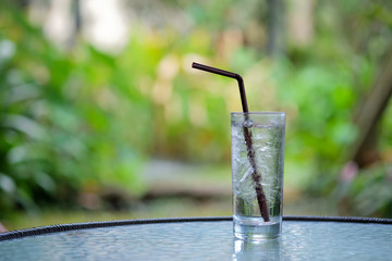 Glass of water with blurred background.