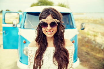 smiling young hippie woman in minivan car