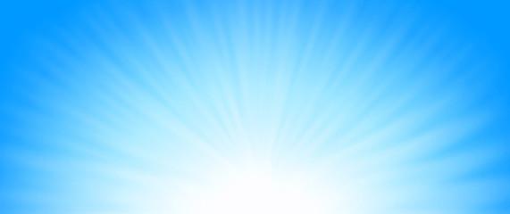 Shiny blue sunrays, cool winter sun background.