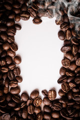 roasted coffee beans with black paper on wooden background, can be used as a background