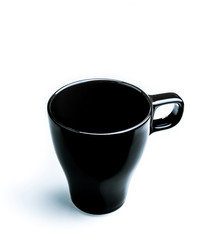 top view of black milk or coffee cup on white background