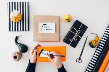 Woman writing Halloween Greeting Card