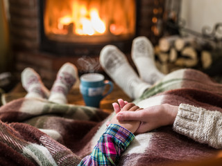 Warming and relaxing near fireplace.