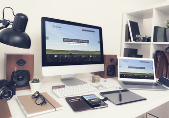 Desktop Computer and Laptop on a Neat Desk with Gadgets Mockup