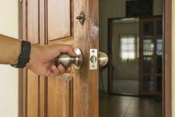 abstract scene of man open the wood door to room