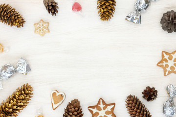 decoration for the Christmas celebrations/ flat layout of festive objects on a wooden background simulating winter