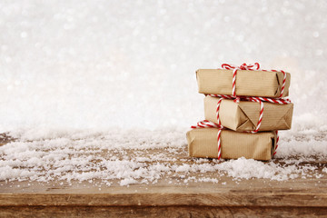 handmade gift boxes over snowy wooden table