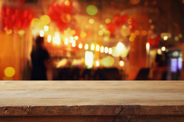 table in front of abstract blurred restaurant lights